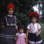 Me with my older sisters. Love the hats! 